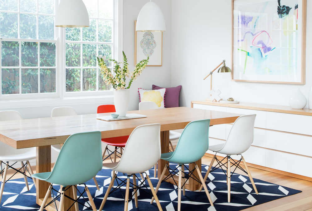 Dining room with soft turquoise chairs