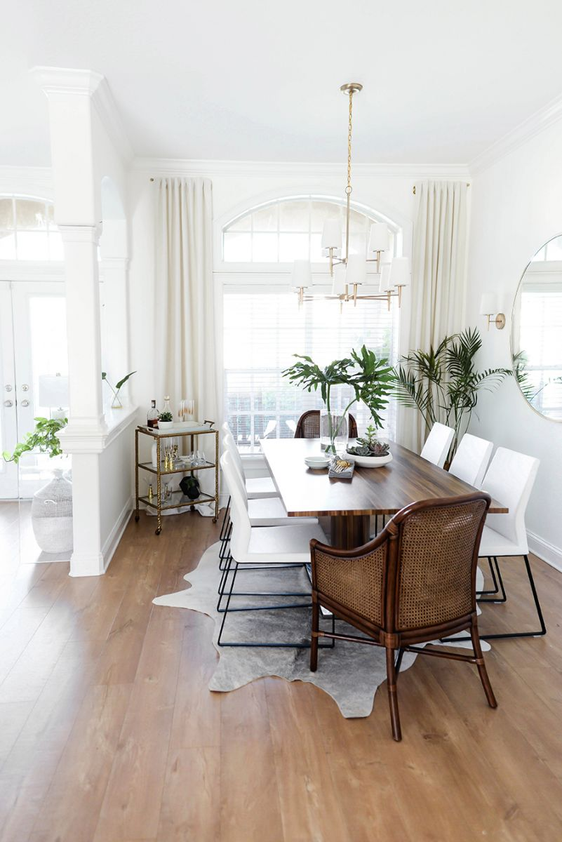 Dining room with white and brown chairs