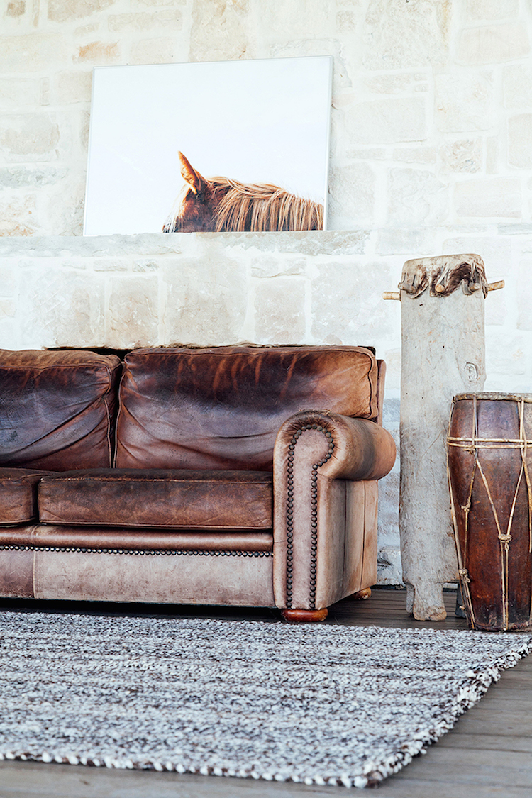 Distressed brown leather sofa with drums