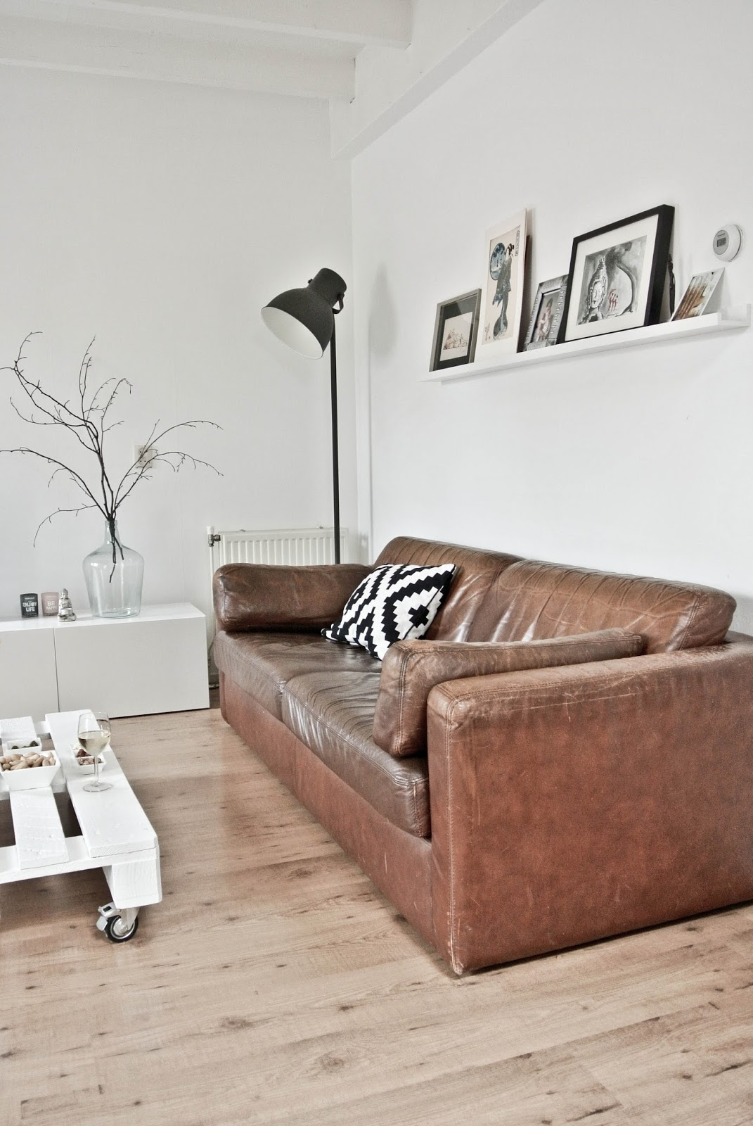 Distressed leather sofa in minimal living space