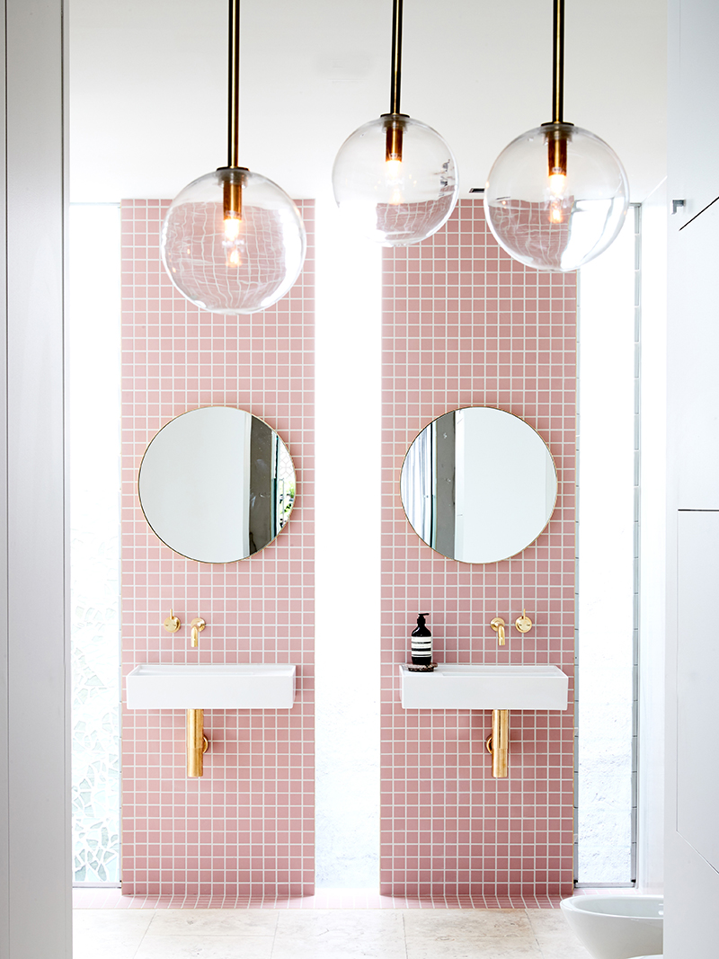 Double vanity bathroom with pink tiles