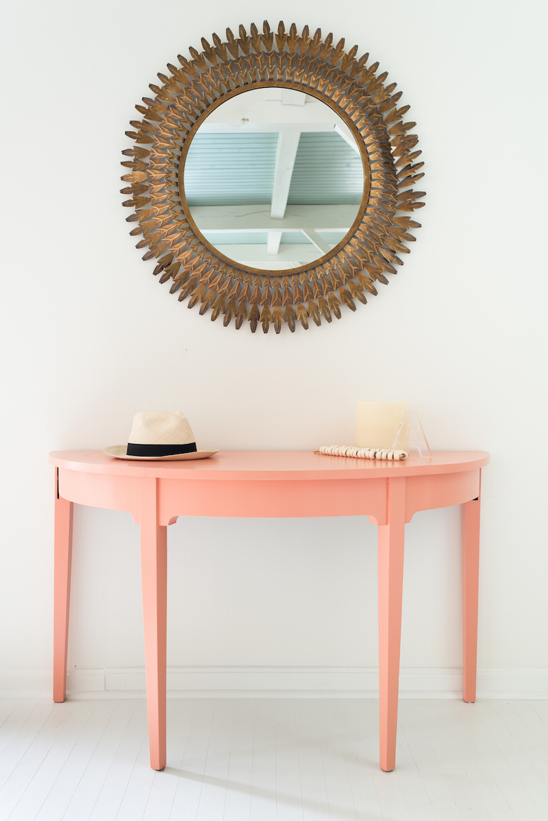Entryway with peach half moon table