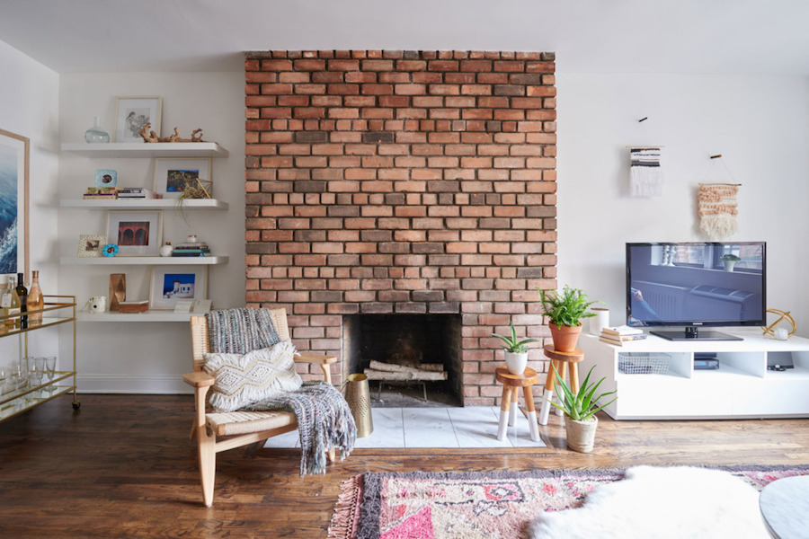 Exposed brick fireplace in new york living room