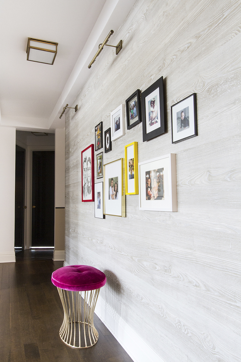 Gallery wall and pink stool by Lilly Bunn