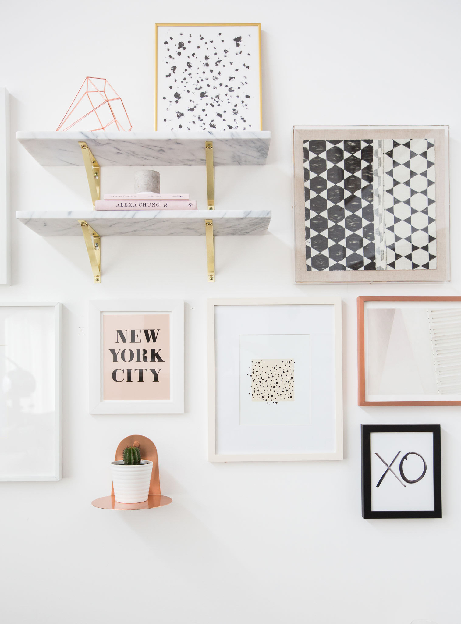 Gallery wall with marble shelving