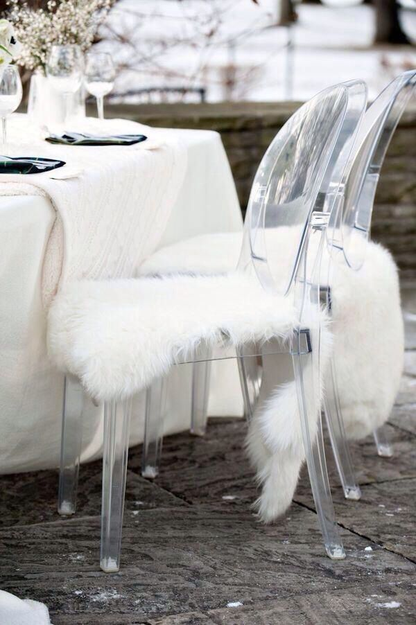 Ghost Chair with white faux sheepskin rug as seat cushion