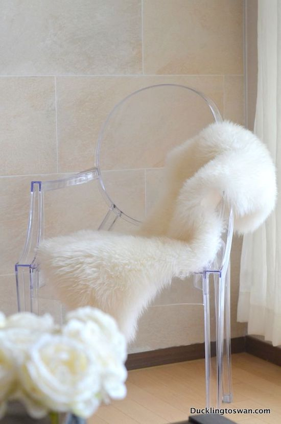 Ghost chair with white faux fur seat cushion