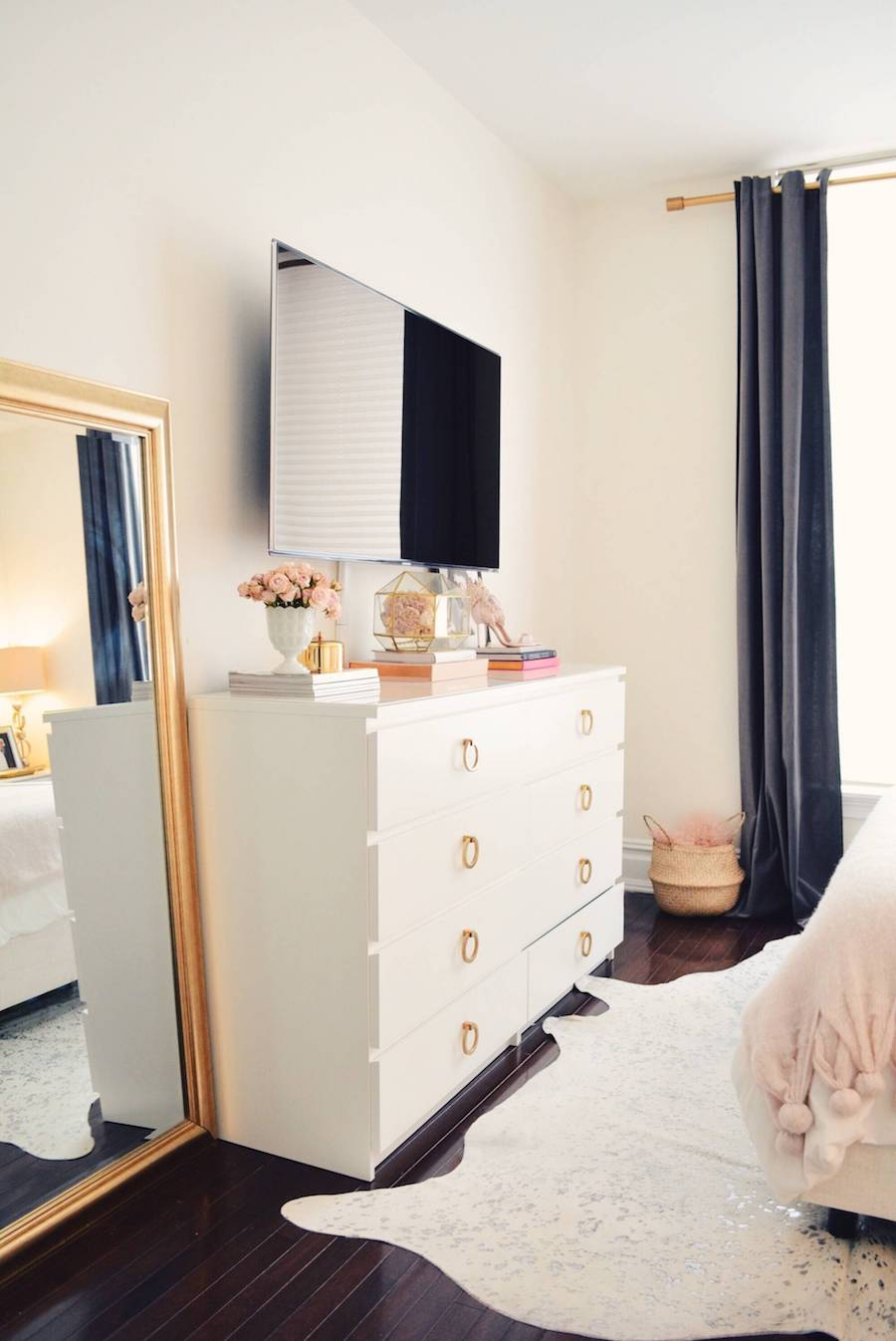 Gold full length mirror with white dresser and gold pulls