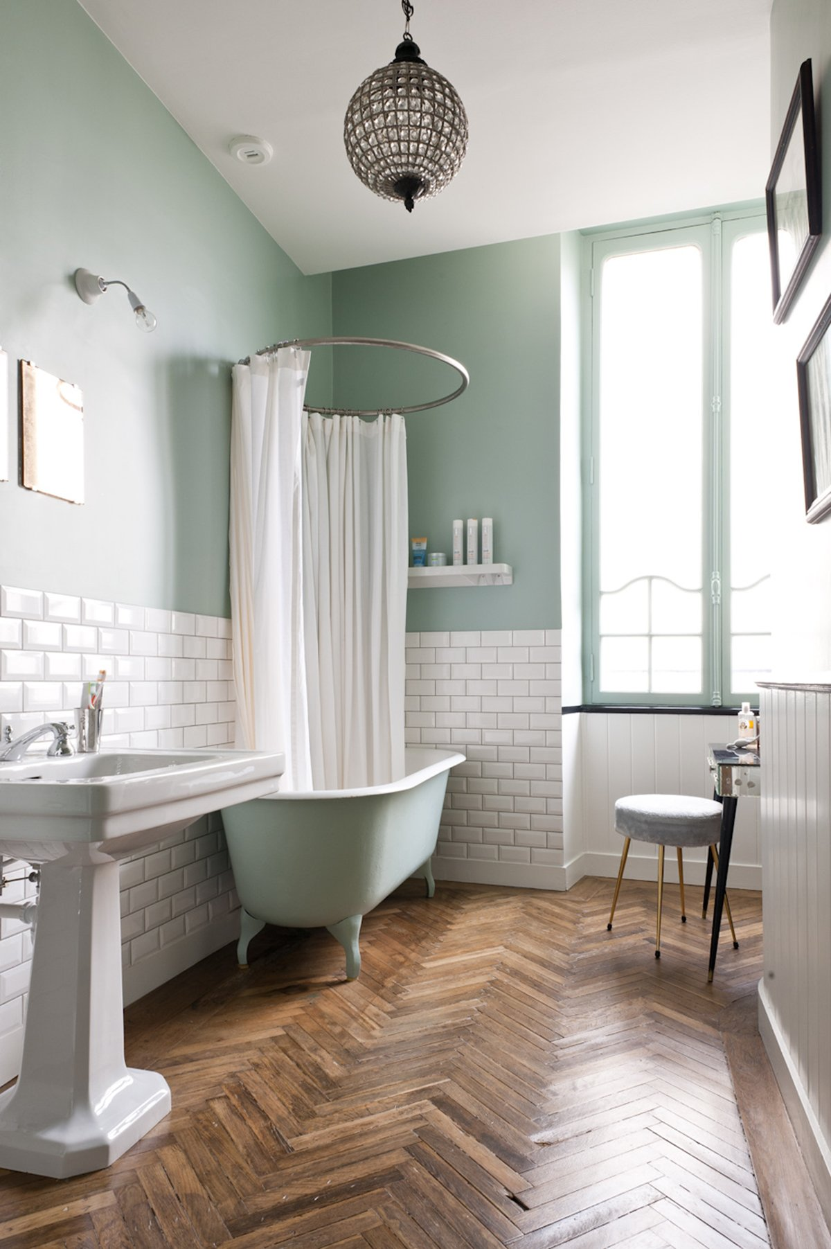 Hardwood floor bathroom with freestanding tub