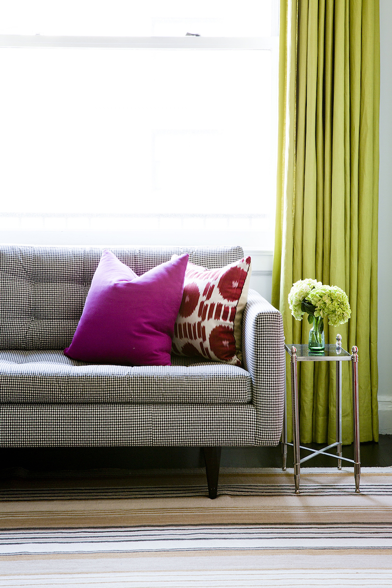 Lime green curtains behind couch via Lilly Bunn