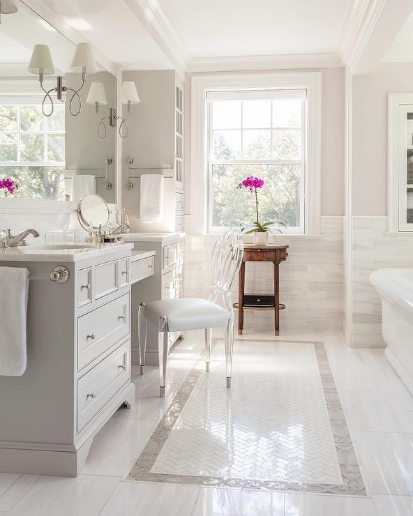 Ghost chair inside grey bathroom vanity