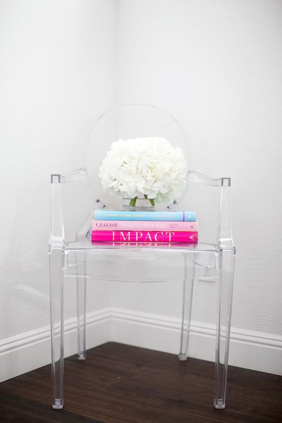 Ghost chair with pink books and white flowers