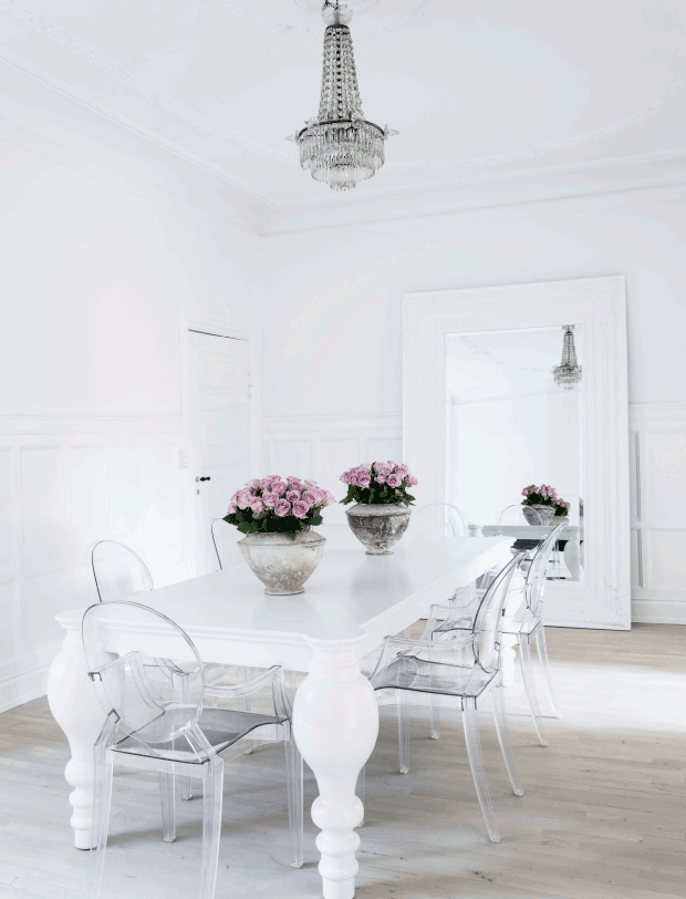 Ghost Chairs With White Dining Table And Crystal Chandelier
