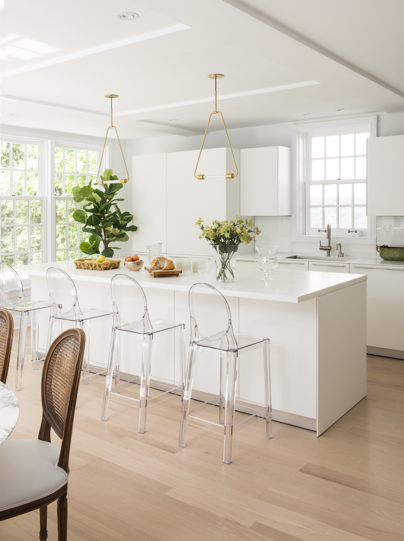 Lucite dining stools in white kitchen via MHOUSE