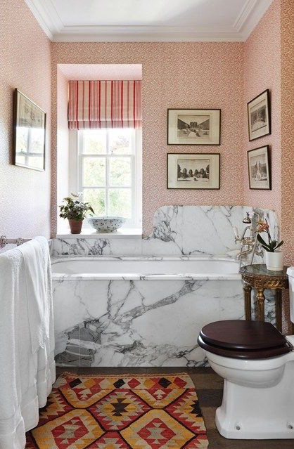 Marble bath tub with pink wallpaper