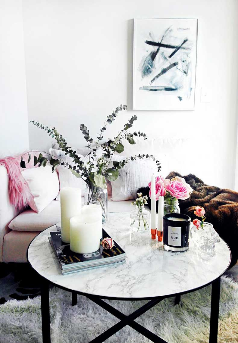 Marble coffee table with black base via The Everygirl