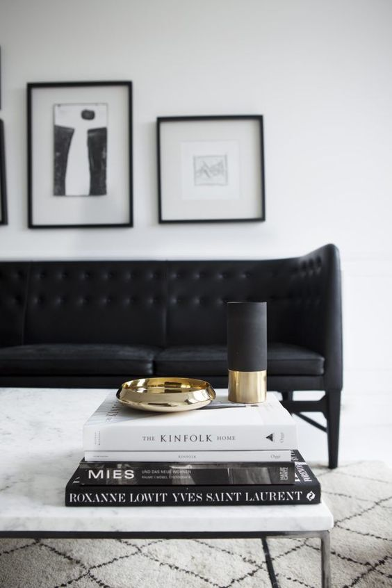 Marble coffee table with black couch