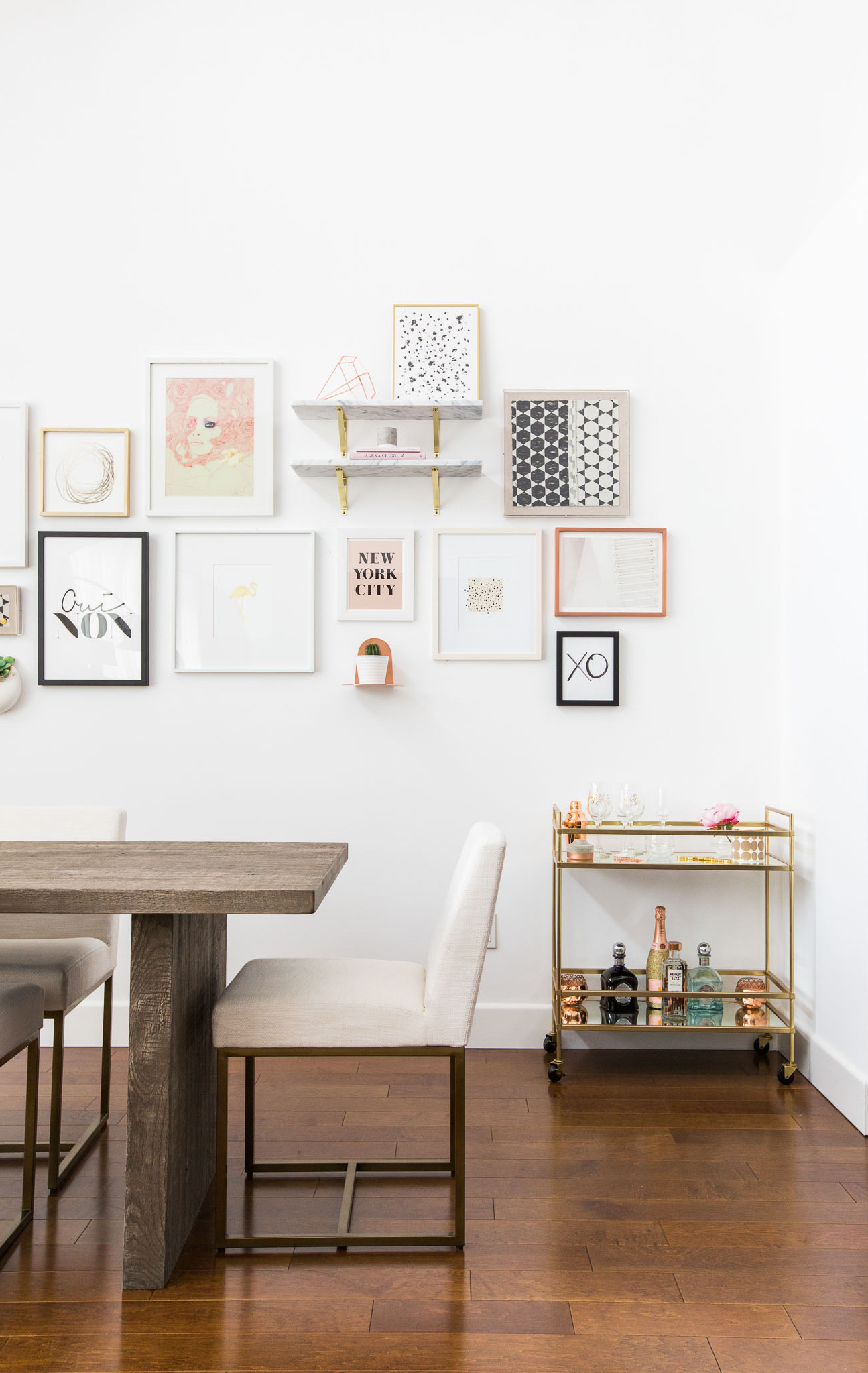 Marianna Hewitt's dining room with barcart and gallery wall