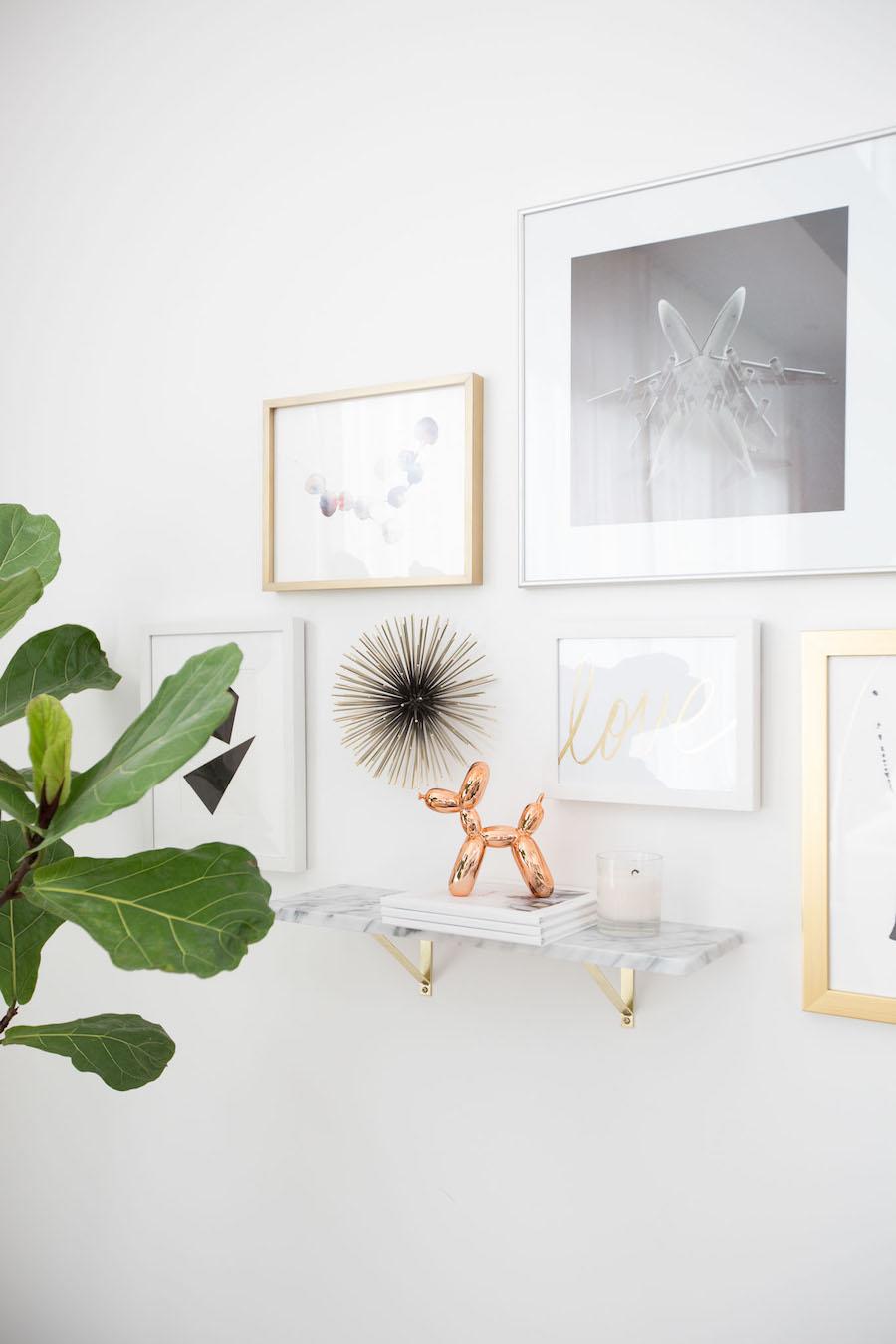 Mini Koons balloon dog on gallery wall