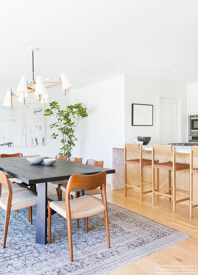 Minimalist Mid-Century Dining Room with Tan chairs