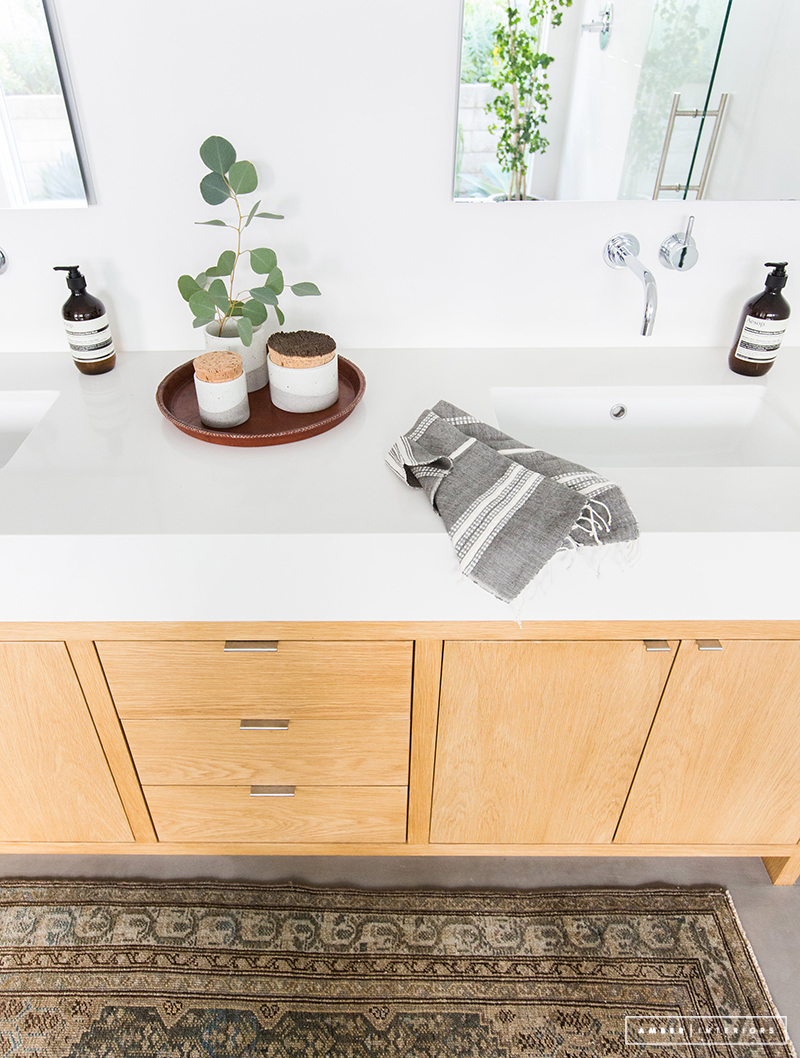 Minimalist Mid-Century bathroom with natural wood vanity