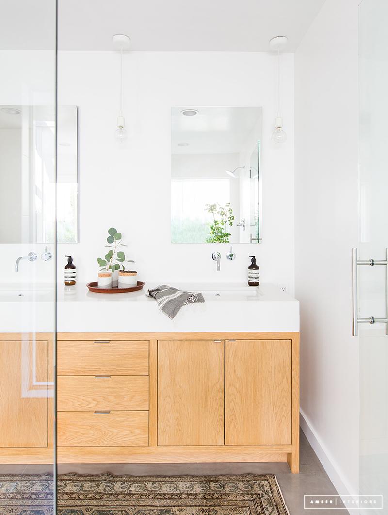 Minimalist Mid-Century bathroom with wood vanity