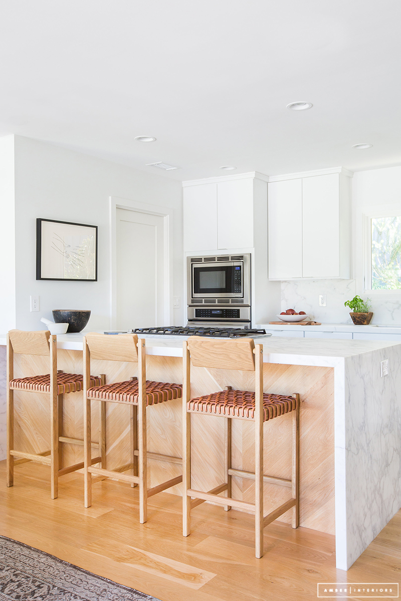 Minimalist Mid-Century kitchen with bar stools