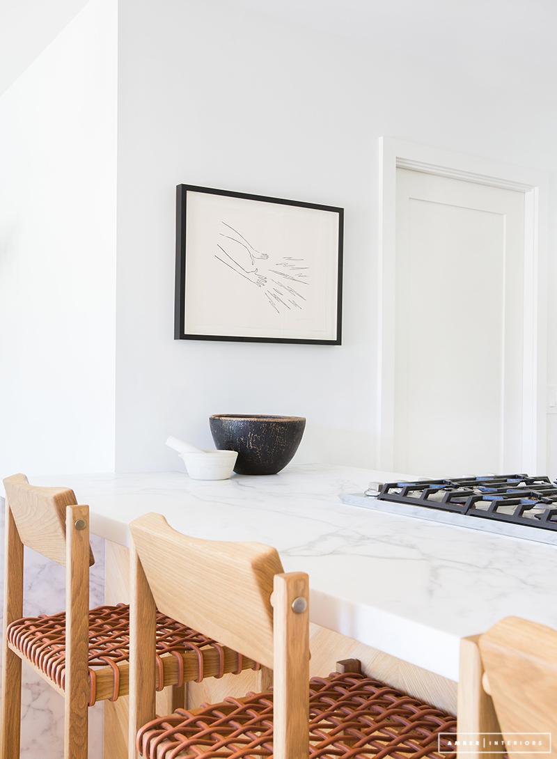 Minimalist Mid-Century kitchen with marble countertop