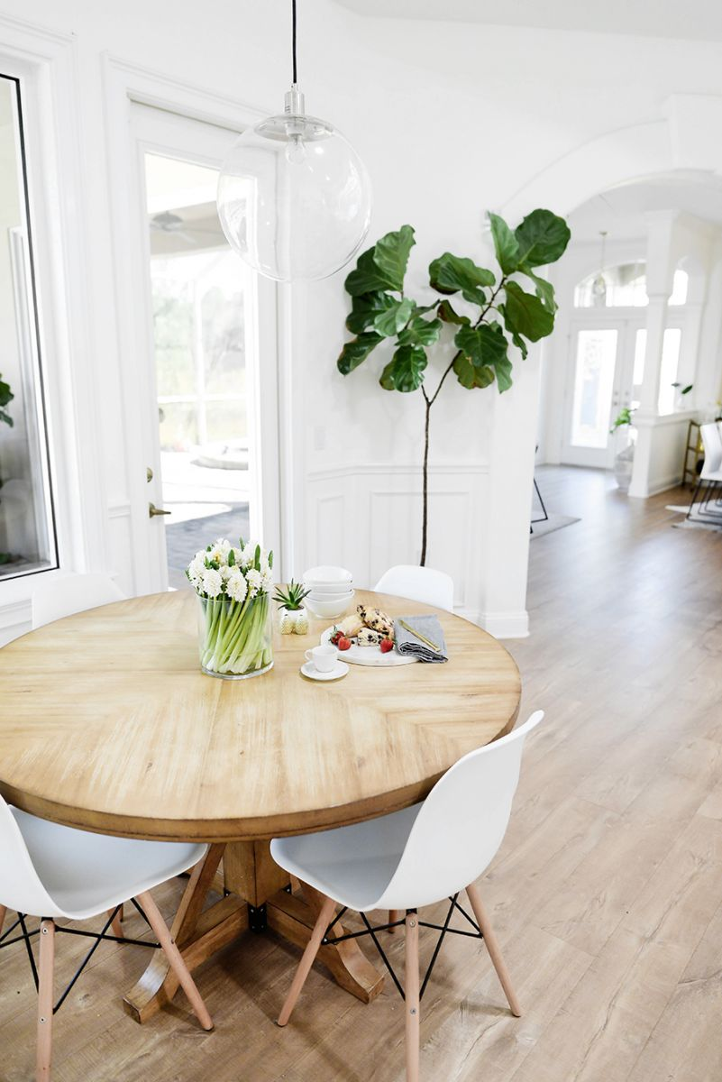 Natural wood dining table with white chairs