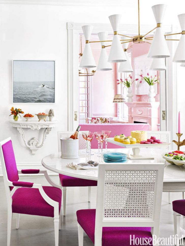 Pink chairs in white dining room via House Beautiful
