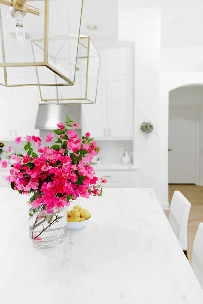 Pink flowers on white marble kitchen counter