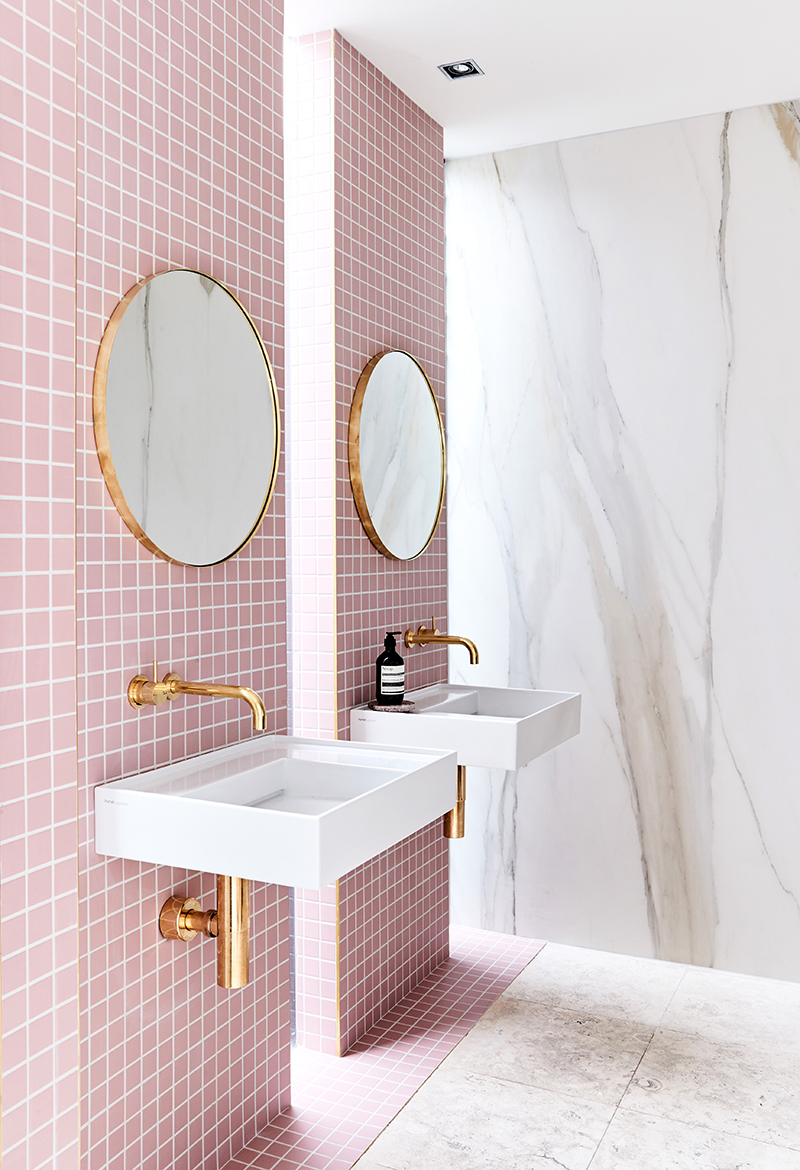 A gorgeous pink tiled bathroom with gold hardware for Pink and gold bathroom accessories
