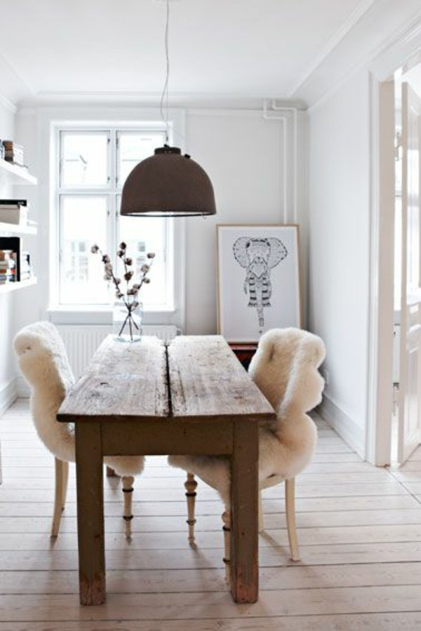 Real wood dining table with fur chairs via the fabulous fleece company