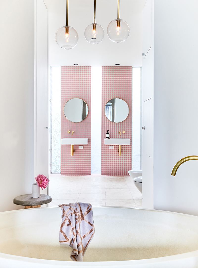 Rebecca Judd's pink tile bathroom with tub