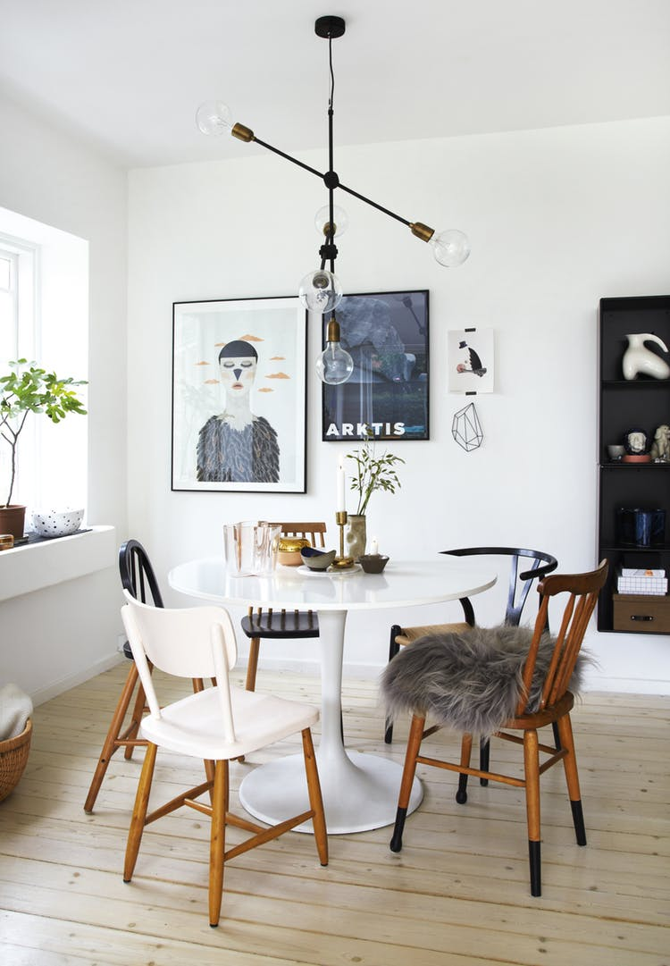 Scandinavian dining room with mismatched chairs