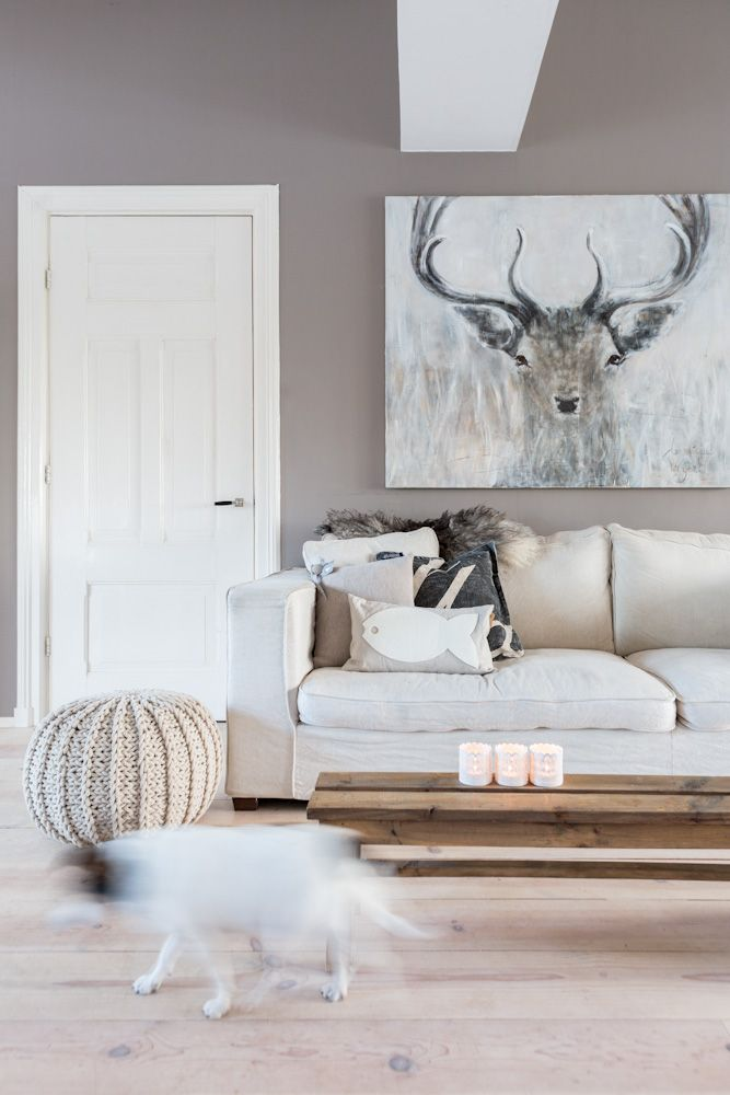 Scandinavian neutral living room with deer artwork