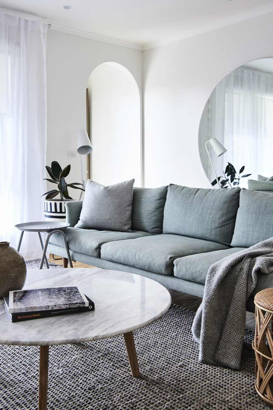 White Marble Table With Muted Blue Couch