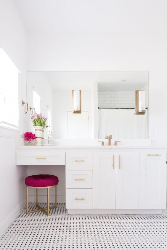 White bathroom with magenta stool