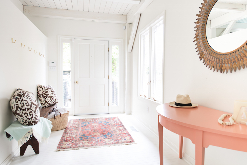 White entryway with oriental rug