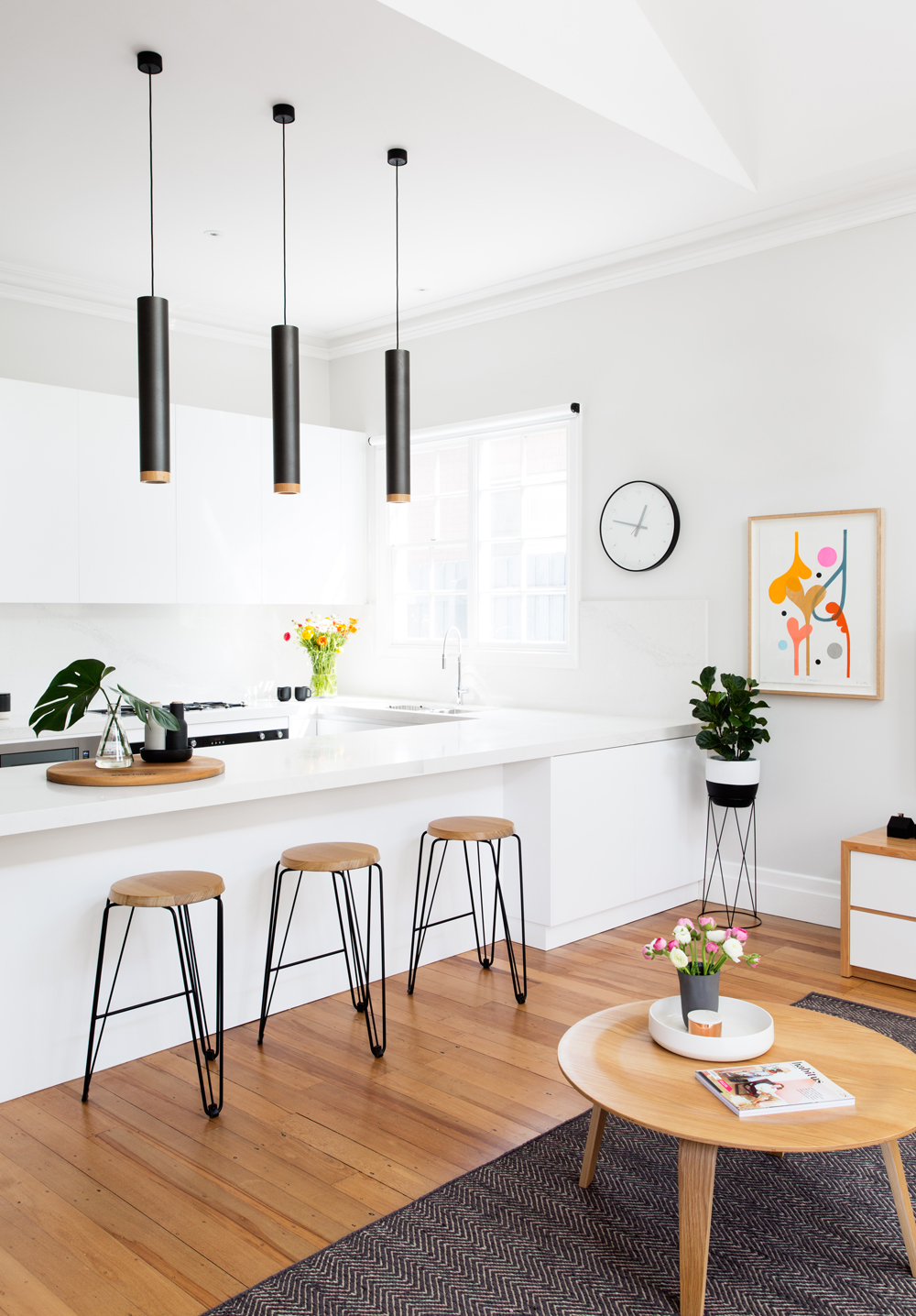 White kitchen with brown stools