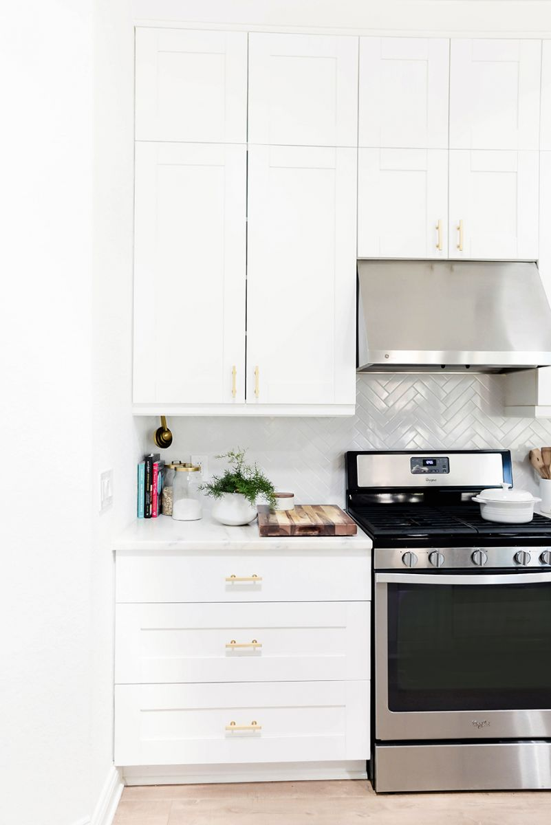 White kitchen with grey tile backsplash