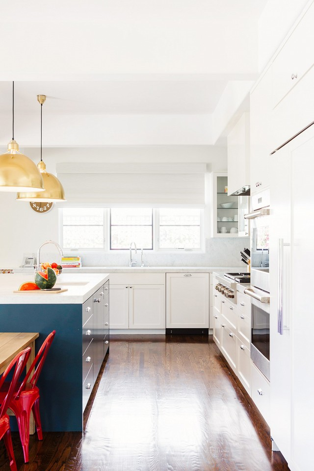White kitchen with hardwood floors and navy cabinets