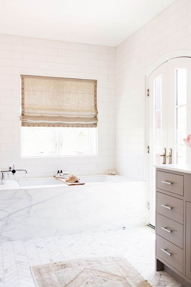 White marble bathroom with light brown vanity
