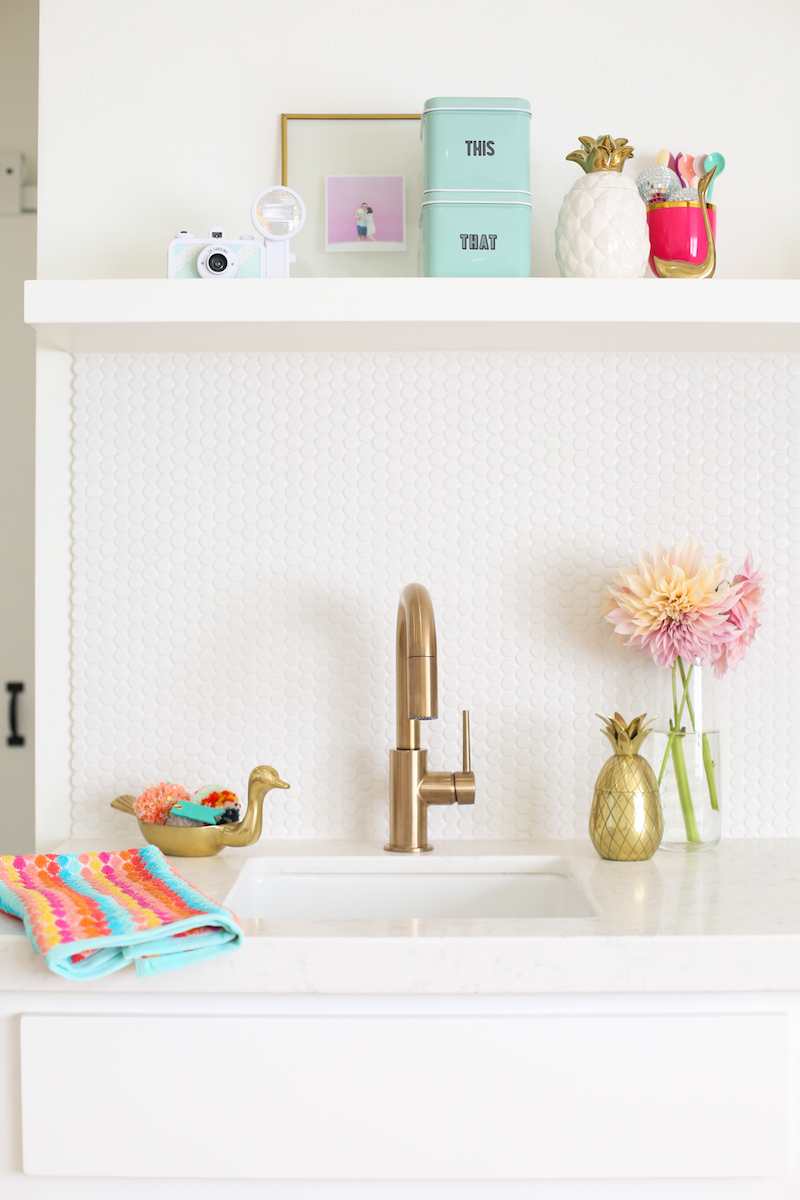 White sink with brass faucet