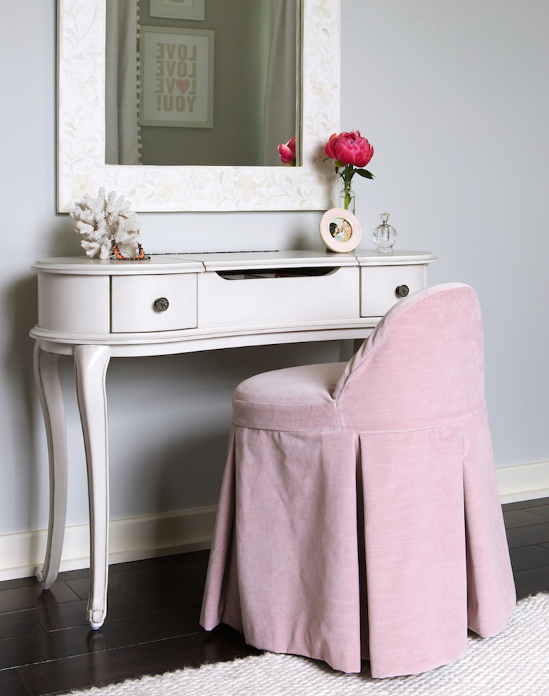 White vanity with blush pink stool