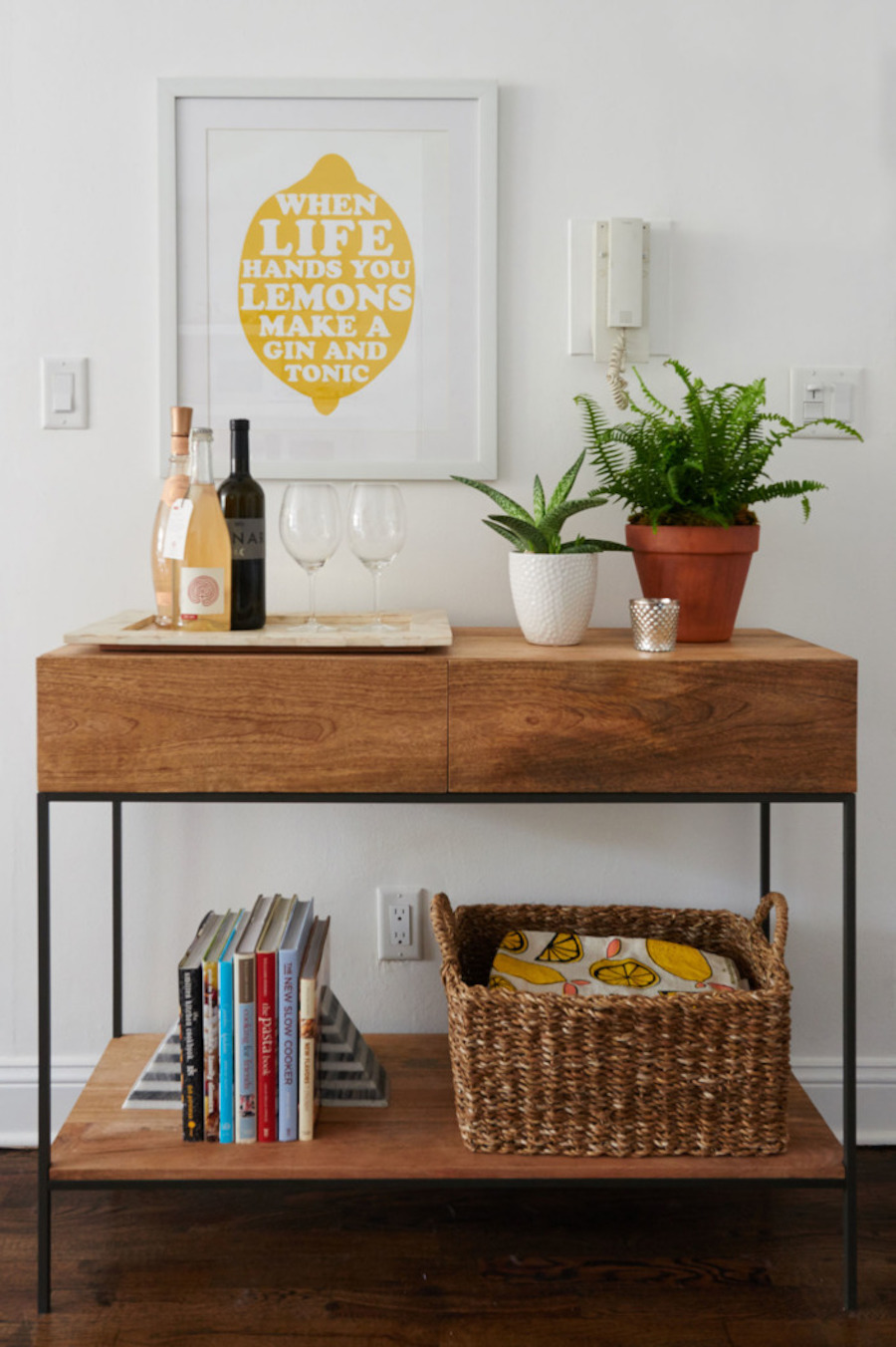 Wood console table with wine glasses