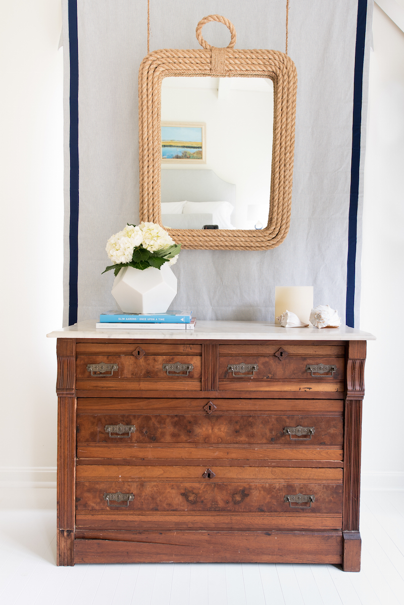 Wooden dresser with nautical rope mirror