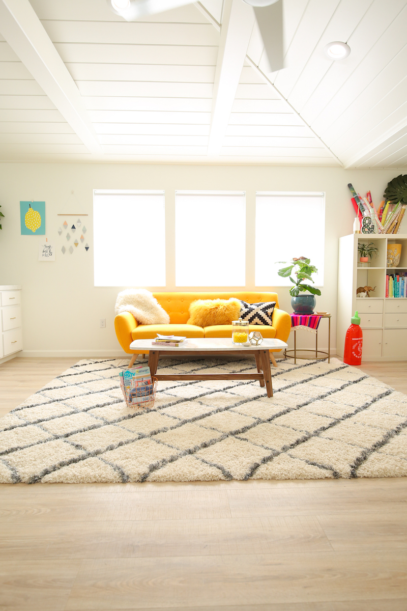 Yellow couch in front of window