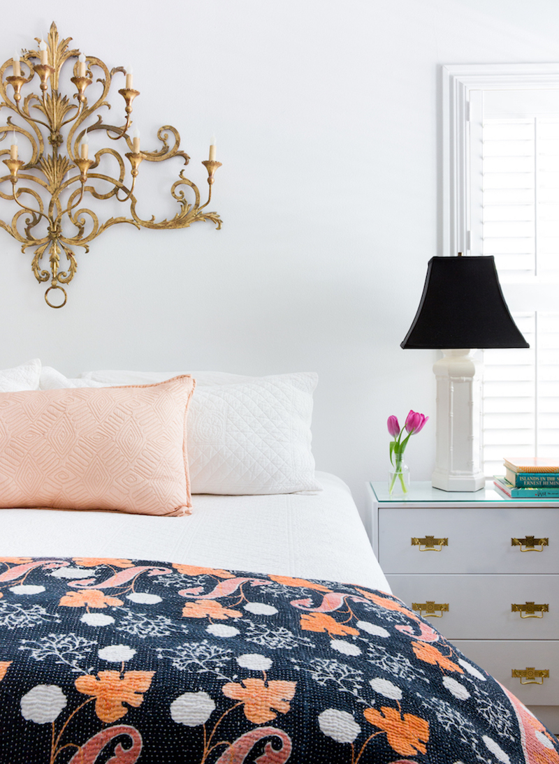 Bedroom with gold sconces