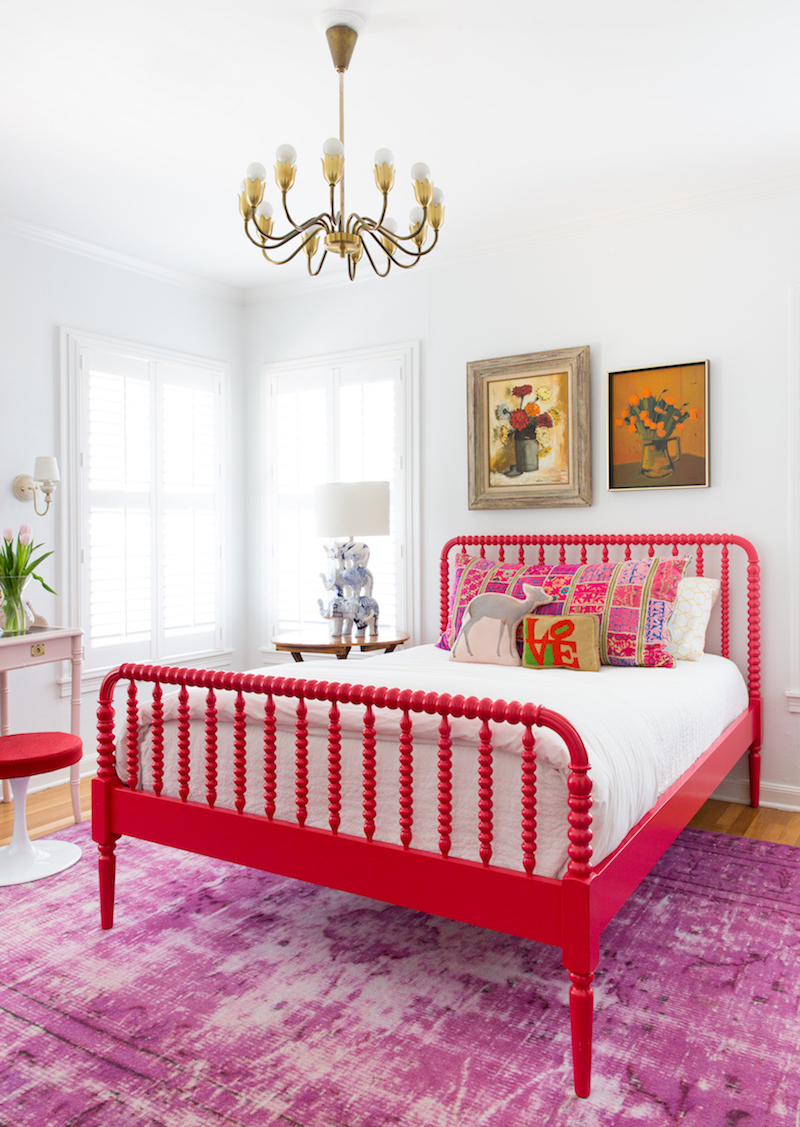 Bedroom with red headboard